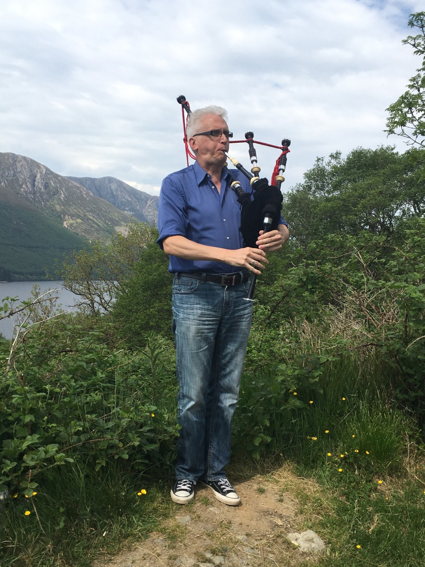 Rob piping in the Highlands.jpg
