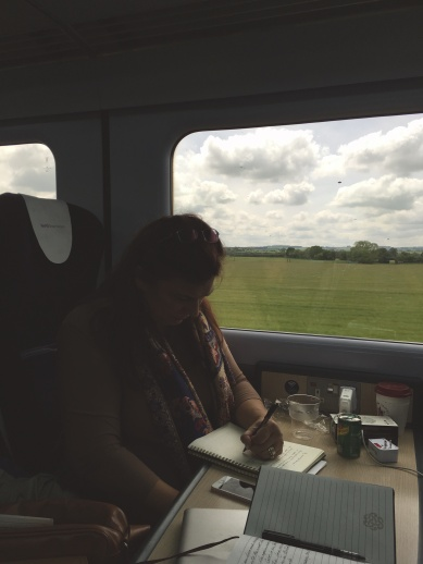 Rae writing on the train to Wales.jpg