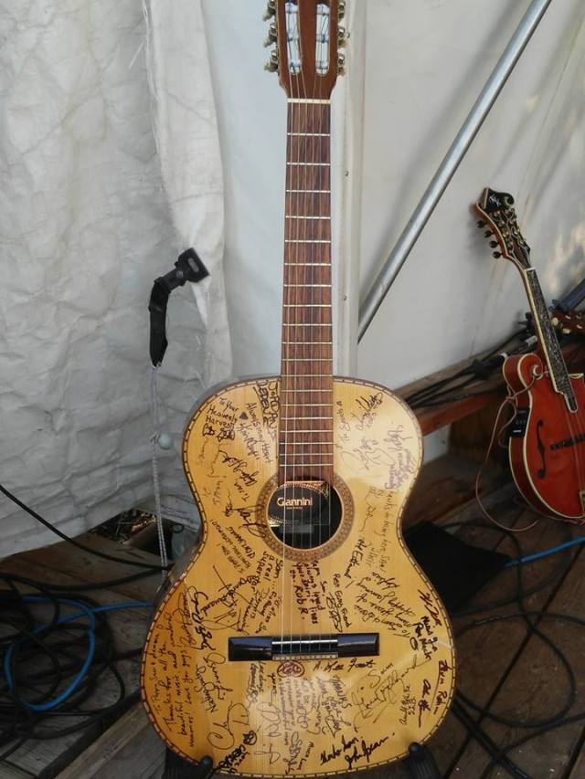Sam's guitar siigned by musician friends .jpg